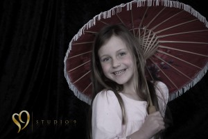Lovely little girl having fun in the studio.