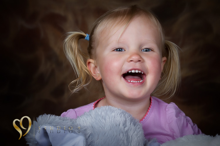 Fun kids portraits with soft toys.