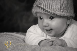 Lovely monochrome portrait of baby in the studio.