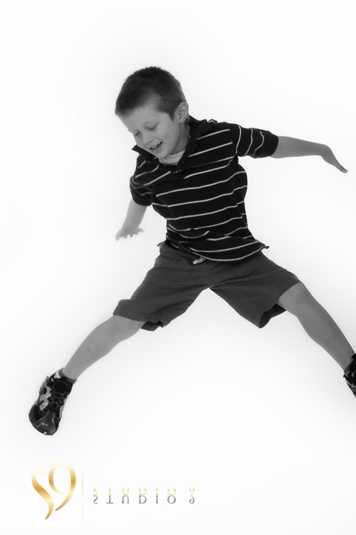 Jump. Fun kids photography at studio9.