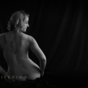 Black and white implied nude photography with Jamie at studio9.