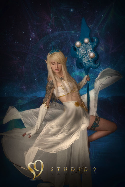 janna league of legends cosplay with flowing dress and staff.